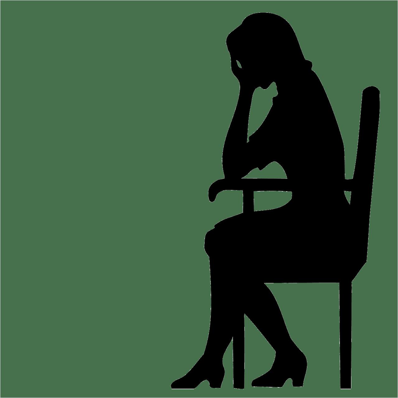 悩んでいる女性のシルエット